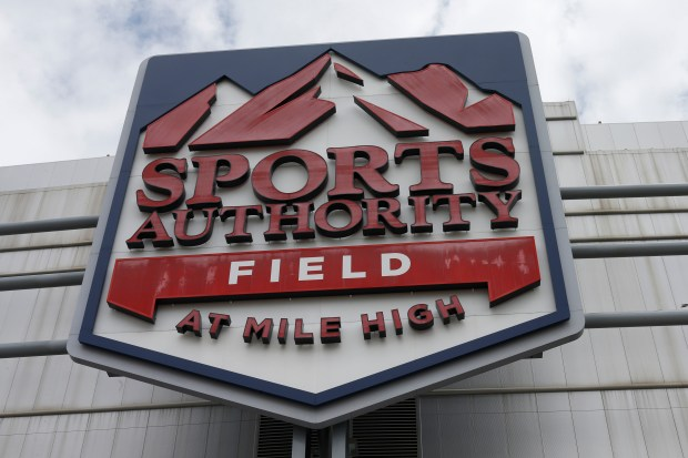 In this Thursday, May 26, 2016, photograph, the sign for Sports Authority Field at Mile High is shown on the south end of the stadium that is the home of the NFL football team Denver Broncos in Denver. The demise of Sports Authority has reignited a fight in Colorado over the future of the Denver Broncos' stadium, a place long tied to the city's identity. Sports Authority hopes to sell off its naming rights to the stadium, but the Broncos and officials appointed to run the taxpayer-built stadium are fighting that in bankruptcy court. (AP Photo/David Zalubowski)