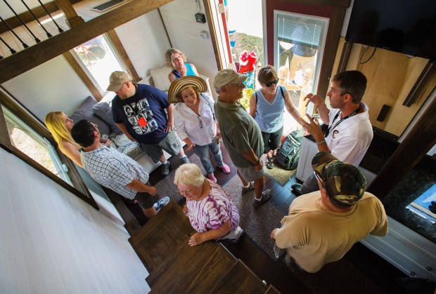 Mike Bedsole of Tiny House Chattanooga talks to visitors about his tiny home Saturday, Aug. 8, 2015, during the Tiny House Jamboree at the Western Museum of Mining and Industry in Colorado Springs. The jamboree continues Sunday. (The Gazette, Christian Murdock)