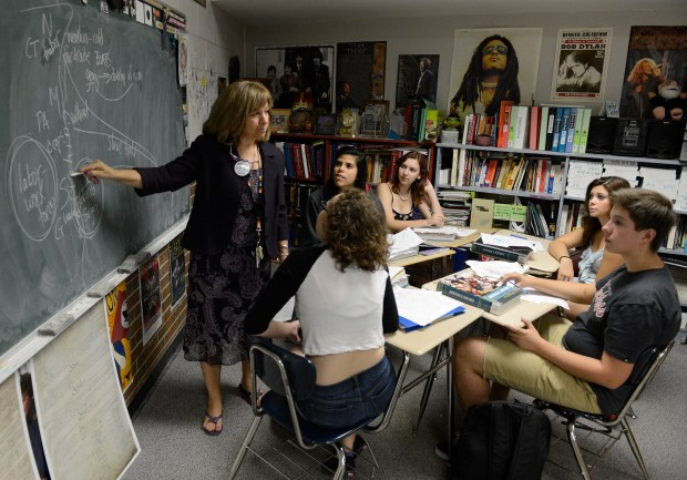 WHEAT RIDGE, CO. - SEPTEMBER 25: Wheat Ridge High School teacher, Stephanie Rossi, left, teaching during her sophomore AP U.S. History class Thursday afternoon, September 25, 2014. Rossi is against the Jefferson County School board member's proposal to change the AP U.S. History curriculum which includes promoting patriotic material, respect for authority and the free-market system and avoiding material about civil disorder, social stripe and disregard for the law. (Photo By Andy Cross / The Denver Post)