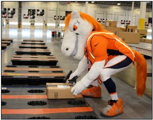 Miles, the Denver Broncos' mascot, showed up on day one for Amazon's first Colorado employees. Miles took photos, led stretches, and even helped process the building's very first pallet of packages.