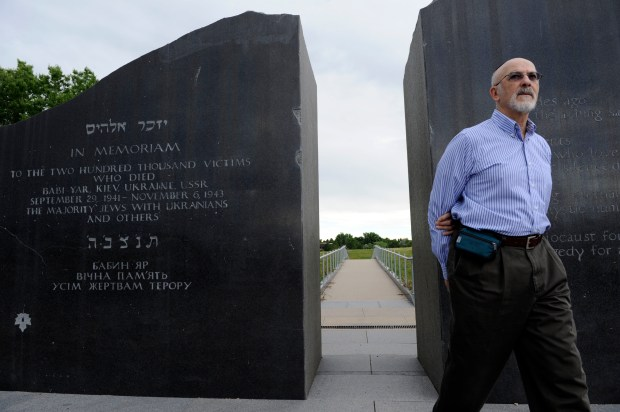 DENVER, CO-- Rabbi Raymond Zwerin, one of the original founders of Babi Yar Park, walks through two very large inscribed granite gates at the entrance to the park in Denver near the intersection of Yale Ave and Havana Thursday afternoon. Babi Yar Park memorializes the massacre of 200,000 people (mostly Jews) in the Babi Yar Ravine in Kiev Ukraine USSR between September 29th 1941 and November 6th, 1943 in the hands of the Nazis during WWII. Zwerin, along with others have organized an additional permanent memorial to be built in the park memorializing those killed in the World Trade Center attacks and worldwide terrorism victims. The group has acquired WTC steel and other artifacts from the WTC site that will be incorporated into the memorial, honoring not only those killed in New York but also those who have died in worldwide terrorism. The WTC material is scheduled to arrive in Denver on Monday. Andy Cross, The Denver Post