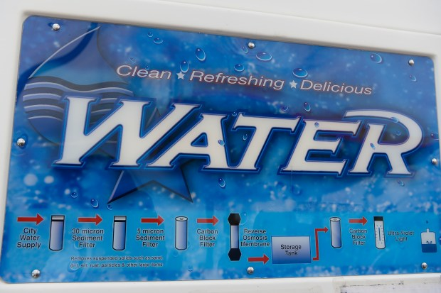 COLORADO SPRINGS, CO - JUNE 8: A sign on a water station outside a 7-Eleven Gas Station depicts the process of the clean water on June 8, 2016. 7-Eleven has the cheapest price for water in the local area, priced at 25-cents per gallon. A invisible toxic chemical has been discovered in the drinking water that affects 70,000 people in the communities south of Colorado Springs. (Photo by Michael Reaves/The Denver Post)