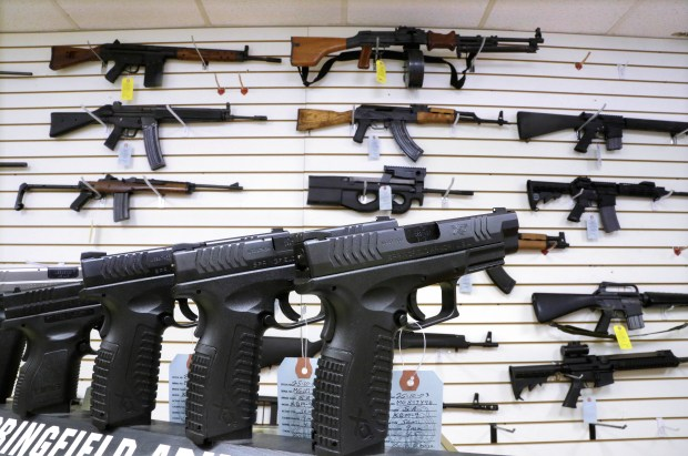 In this Jan. 16, 2013 photo, assault weapons and hand guns are seen for sale at Capitol City Arms Supply in Springfield, Ill.