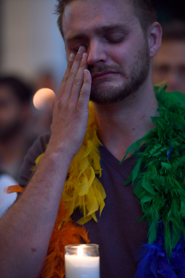 DENVER, CO - JUNE 13: Matt Cantwell wipes a tear as he attends the PFLAG Denver chapter candle vigil June 13, 2016 at Cheeseman Park. A silent candle vigil was held in support of the tragic event at Pulse Night Club in Orlando, Florida. More than 2,00 supporters attended the event.   (Photo By John Leyba/The Denver Post)