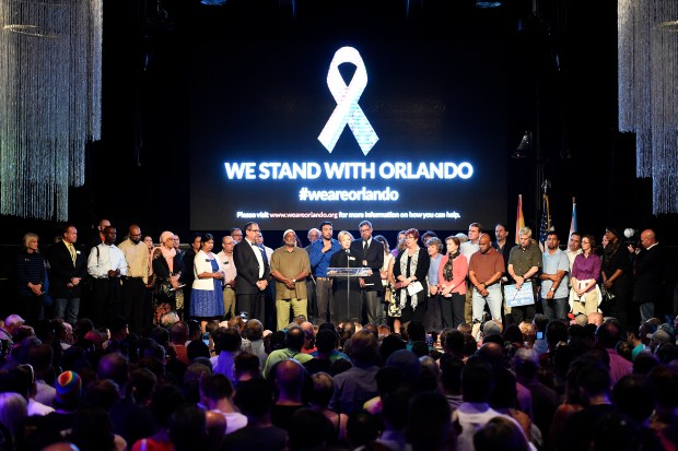 Speakers address a full room of supporters during a vigil for the Orlando shooting victims at Tracks night club in Denver. Community members gathered in support of the victims of the Orlando nightclub shooting in the early morning hours on Sunday.