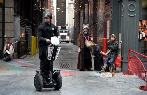 A Denver police officer patrols the 16th Street Mall on a Segway. The city is boosting the number of officers walking the mall from five to 16.
