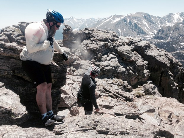 Paul Svendsen, left, looks on as his brother Zan Svendsen, right, spread their father's ashes during Day 5 of Ride The Rockies on Trail Ridge Road on Thursday, June 16, 2016.