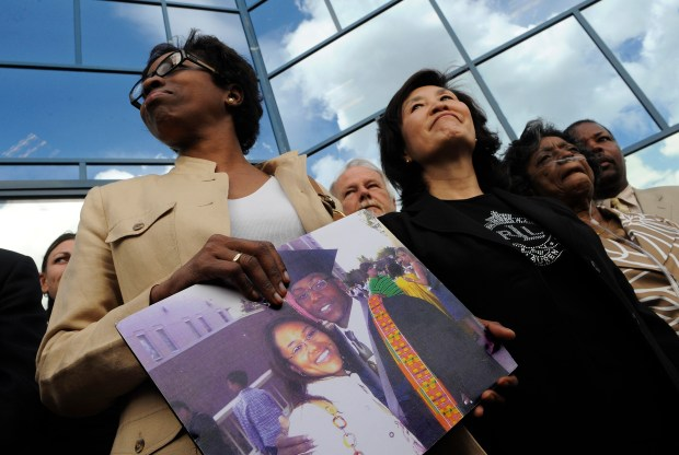Rhonda Fields, left, mother of Javad Marshall-Fields, and Christine Wolfe, mother of Vivian Wolfe, Sylvia Marshall, Javad's grandmother, and family friend gather outside the courhouse, Wednesday, at Arapahoe County Justice Center on May 14, 2008. Sir Mario Owens was found guilty of two counts of first-degree murder. RJ Sangosti/ The Denver Post