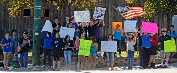 LITTLETON, CO - SEPTEMBER 24: Student walk-outs in Jefferson County continued for the third straight day after students from Chatfield High School and Dakota Ridge High School left classes in protest of school board decisions and proposals, September 24, 2014. Students for the two schools joined together, at the corner of Ken Caryl and Chatfield Blvd. in Littleton, to wave sings. (Photo by RJ Sangosti/The Denver Post)