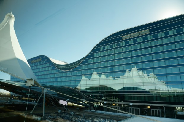 Denver International Airport's terminal as reflected on the new Westin hotel and transit center.