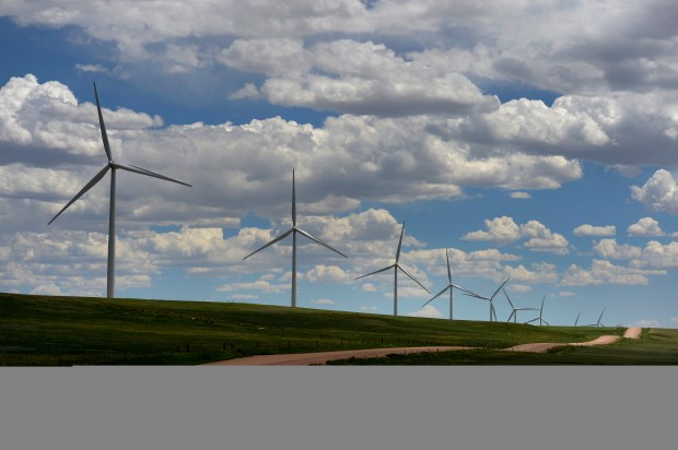LIMON, CO - JUNE 3: NEXTera Energy wind farm has 250 wind turbines that dot the landscape north of Limon, CO on June 3, 2103. The company, located at 22050 County Road 3P leases the land from private land owners who can continue to work the land such as growing crops or raising cattle. (Photo by Helen H. Richardson/The Denver Post)