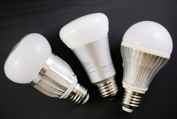 If you have a few bucks to burn, consider replacing older incandescent or halogen bulbs with newer CFL or LED bulbs that put off less heat. (AP file)