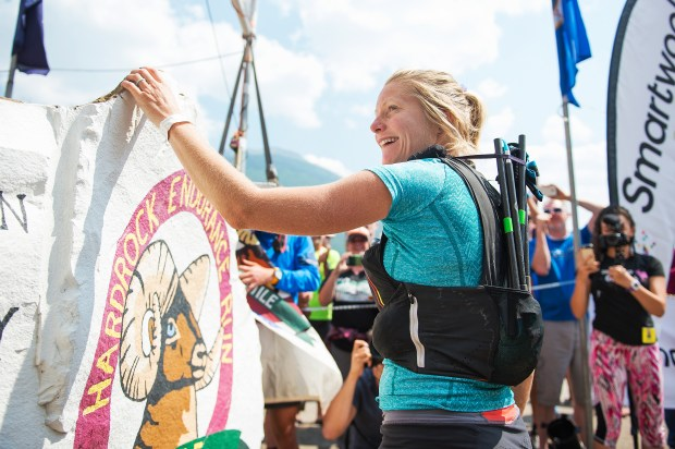 Anna Frost touches the rock at the Hardrock 100 in 2016.