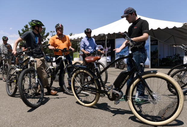 LAKEWOOD, CO - JUNE 17:  The Colorado Mills shopping mall in Lakewood is hosting an Electric Bike Expo over the weekend.   Paul Jones, right of Bosch gets riders ready for a test ride on Bosch equipped ebikes at the expo on Friday, June 17, 2016.  The ebikes allow riders to fully pedal, partially pedal or use all electric power for the power source. (Photo by Cyrus McCrimmon/The Denver Post)