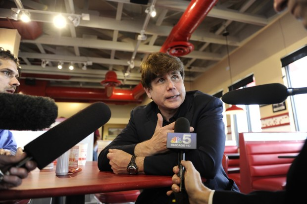 Former Illinois Gov. Rod Blagojevich talks with reporters during a stop at Freddy's Frozen Custard & Steakburgers before turning himself in to the Federal Correctional Institution (FCI) Englewood just a few minutes away in Littleton, Colorado, to begin his 14-year prison sentence on corruption charges Thursday, March 15, 2012. The 55-year-old Democrat becomes the second Illinois governor in a row to go to prison for corruption. Joe Amon, The Denver Post