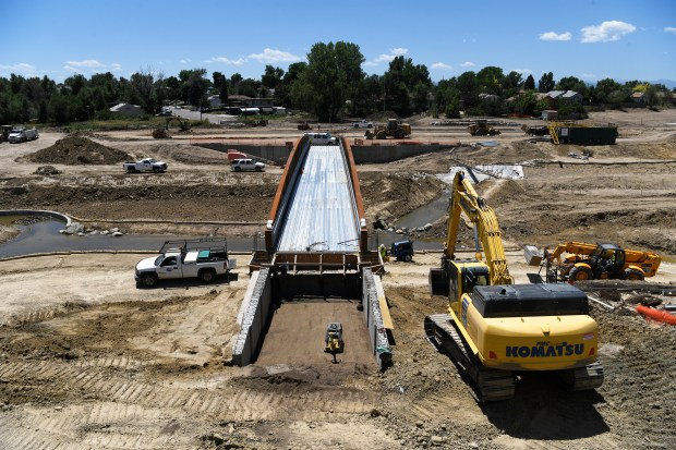 WESTMINSTER, CO - July 13: Construction crews work on a pedestrian bridge across the Little Dry Creek across from RTD's Westminster Station under construction, (below) which will run the B Line commuter rail from Westminster to Union Station July 13, 2016. The official opening of the 6.2 mile commuter rail line is scheduled for July 25, 2016, which will connect riders to the new University of Colorado A Line, several light rail connections and local and regional buses. (Photo by Andy Cross/The Denver Post)