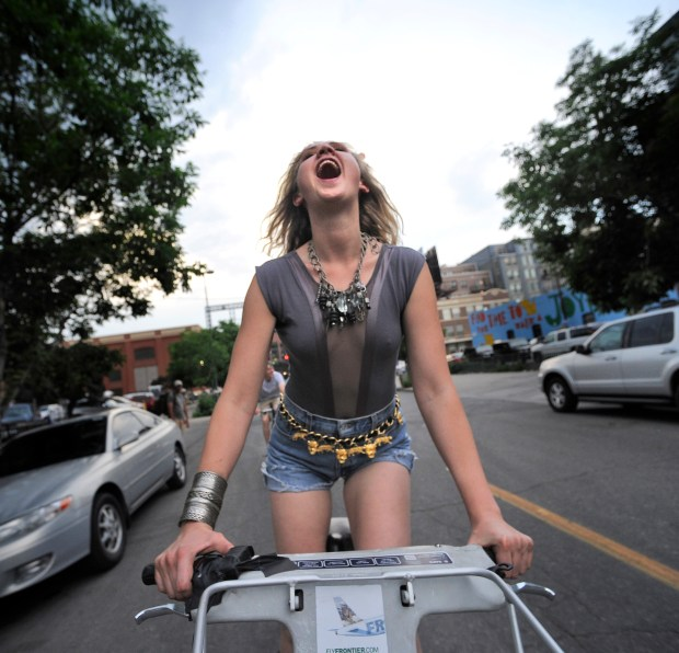 Madaline Snyder rides a Denver B-Cycle for Denver Cruisers on the first Wednesday of June 2013.