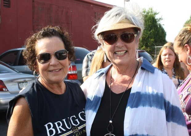 Carol Kriewald (R) of Fort Collins and Faye Bell wait in line for a free Blake Shelton concert at the Grizzly Rose in Denver on July 28, 2016.