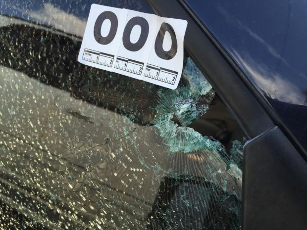 A bullet busted the passenger side window of a car parked on Market Street during a shootout that erupted shortly after midnight in busy LoDo.