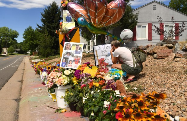 DENVER, CO - JULY 19: Ranee Woof visits a memorial for 14-year-old Cole Sukle, a Denver boy who was killed by an 81-year-old driver in a car accident in southeast Denver, July 19, 2016. Woof son know Cole form science club. (Photo by RJ Sangosti/The Denver Post)