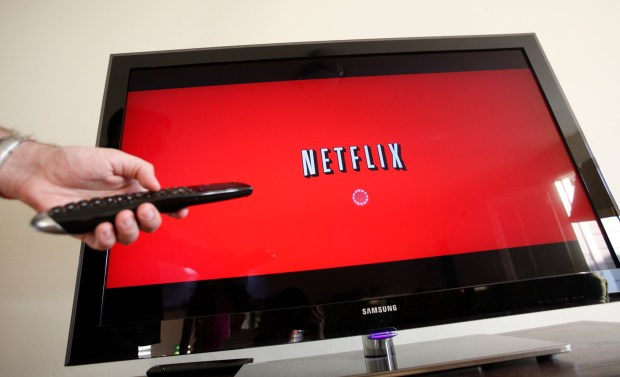 In this July 20, 2010 file photo, a Netflix customer uses the service in Palo Alto, Calif.