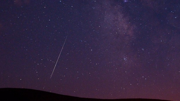 A Perseid meteor streaks across the sky.