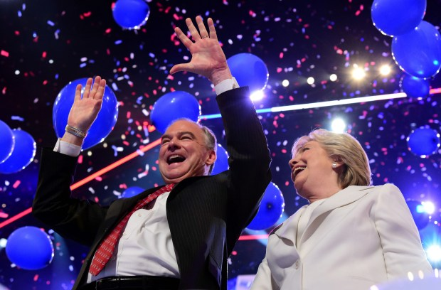 Tim Kaine and Hillary Clinton celebrate as balloons fall Thursday night at the Democratic National Convention in Philadelphia.