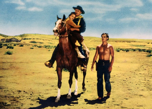 """This image released by Turner Classic Movies shows Natalie Wood, from left, John Wayne and Jeffrey Hunter in a scene from the 1956 John Ford western, """"The Searchers."""" For many filmmakers, TCM isn't just a favorite channel, it's a lifeblood. Among directors from Martin Scorsese to Paul Thomas Anderson it's a common refrain that Turner Classic is a constant source of inspiration and a beloved background in their lives."""