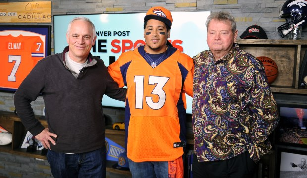 Connecticut based hip-hop artist The Mad Fanatic (a.k.a. Andrew Young) poses for a photo with Denver Post sports columnists Woody Paige and Mark Kiszla on The Sports Show on the DPTV stage on Friday, January 22, 2016. The Mad Fanatic run The Broncos Gang, a national organization of Broncos fans who advocate against fan violence and try to give Broncos fans a home in every city.