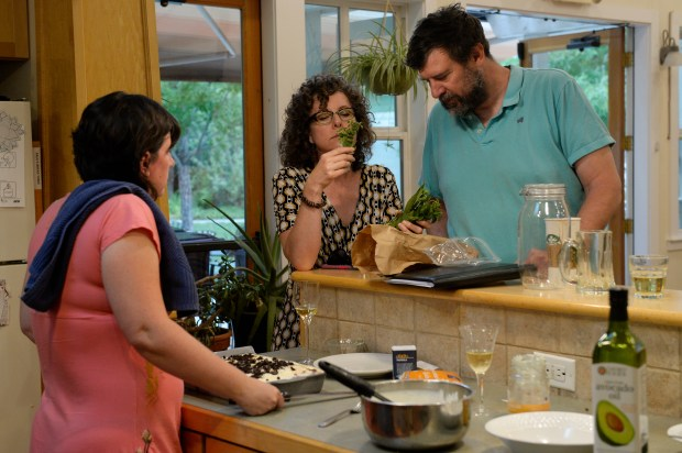 Kellie Teter, center, examines some fresh herbs with Adam Alleman (R) and his wife, Tracy Alleman, while making dinner in the Common House at Hearthstone Co-Housing Community on July 21, 2016, in Denver, Colorado. Hearthstone Co-Housing Community incorporates 33 town home units as well as a common house and common green areas. A new co-housing community, Aria Co-Housing, will be built at the former Marycrest convent site at the intersection of Federal Boulevard and West 52nd Avenue. (Photo by Anya Semenoff/The Denver Post)