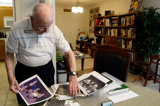 HIGHLANDS RANCH, CO - JULY 26: Bill Koch leafs through old photographs and papers in his apartment at Wind Crest Retirement Community on July 26, 2016, in Highlands Ranch, Colorado. Koch, a physicist who moved to Wind Crest in 2007, worked on the Manhattan Project during World War II. Today he serves as an adjunct professor at the University of Denver, and gives lectures to his fellow Wind Crest residents. (Photo by Anya Semenoff/The Denver Post)