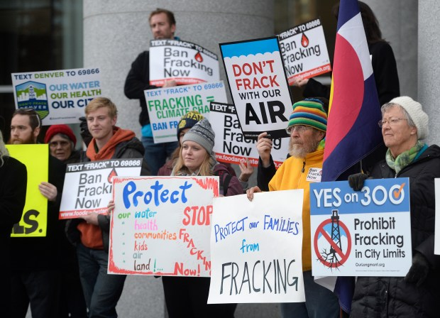 DENVER, CO - DECEMBER 09: Protesters gathered out front of the Colorado Supreme Court Building to protest fracking before hearings on local communities and fracking on Wednesday, December 09, 2015. The two hearings focus on Longmonts 2012 ban on fracking and Fort Collins 2013 moratorium. In both cases, the oil and gas industry sued to overturn these measures, contending that the local governments have no power to regulate the industry, or control the location and practices of any oil and gas activities in their borders. (Photo by Cyrus McCrimmon/The Denver Post via Getty Images) (Photo by Cyrus McCrimmon/The Denver Post via Getty Images)