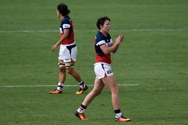 United States player Jillion Potter (1) claps after her team took a 12-5 lead late against Australia during their 12-12 rugby sevens tie at Rio 2016 on Sunday, August 7, 2016.