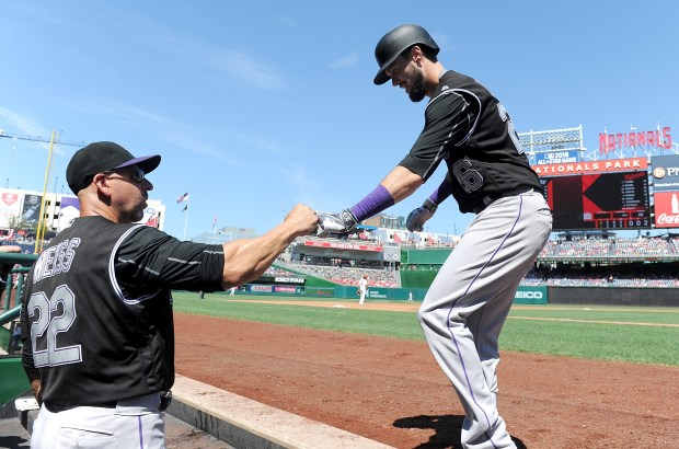 WASHINGTON, DC - AUGUST 28: David Dahl #26 of the Colorado Rockies celebrates with manager Walt Weiss #22 after hitting a home run in the third inning against the Washington Nationals at Nationals Park on August 28, 2016 in Washington, DC. (Photo by Greg Fiume/Getty Images)