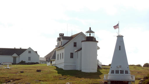 A lighthouse seen during a lighthouse tour operated by Monhegan Boat Line out of Port Clyde, Maine. The tour included a demonstration of lobstering by a guide and third-generation lobsterman.