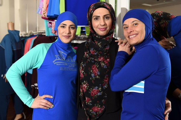 Muslim models display burkinis at a shop in Sydney, Australia. Part swimsuit, part all-covering burqa, the garment has sparked controversy in France, where it has been banned by some cities.