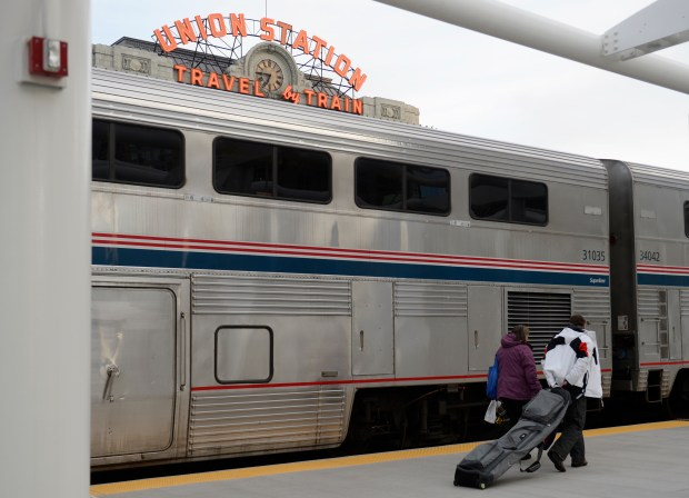 Skiers walk past the train after coming back from Winter Park on Saturday, March 14,2015 at Union Station in Denver, Colorado. This was the return for the first round trip for the Winter Park Express ski excursion train since the train was shut down in 2009. (Photo By Brent Lewis/The Denver Post)