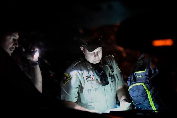 Otero County sheriffs deputy Tyerek Kirkland searching a backpack