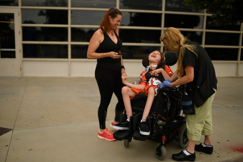 Jack Splitt, 15, of Wheat Ridge High School, center, meets his mother Stacey Linn, left, and registered nurse Lisa Krecklow after his first day of the school year. Jack, who has cerebral palsy, is allowed to wear a skin patch to school, which delivers a cannabis-derived treatment. Jack's Law, House Bill 1373, permits parents or another designated caregiver to administer a non-smokable cannabis treatment on school grounds to a student who is a registered medical marijuana patient.