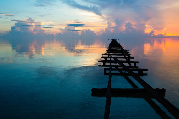 A dilapidated dock at Hotel El Colony in Isla de la Juventud, Cuba, juts out into the still waters of the Bahía de la Siguanea. The hotel was built as a Hilton, but it was confiscated during the revolution.