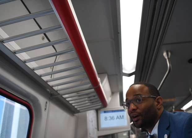 Denver Councilman Albus Brooks looks outside as he ride the new University of Colorado A Line from Union Station to Denver International Airport on April 22, 2016. Brooks returned to be the president of the Denver City Council in mid-2016 after a battle with skeletal cancer.