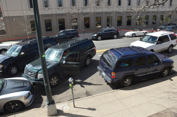 This photo provided by the Denver District Attorney's office of the scene shows Denver police vehicles pinning in the car where Dion Ray Damon was shot by Technician Jeffery Motz on April 12, 2016.