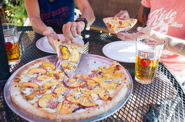 A photo of The Palisade Peach pizza at The Hot Tomato in Fruita, Colorado.