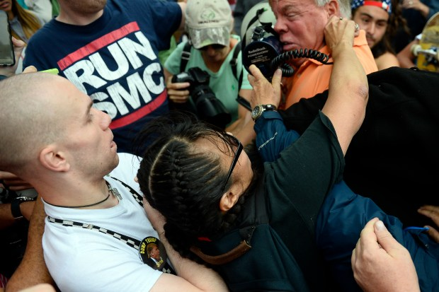 Protesters clash in a fight outside the Western Conservative Summit in Denver on July 1.