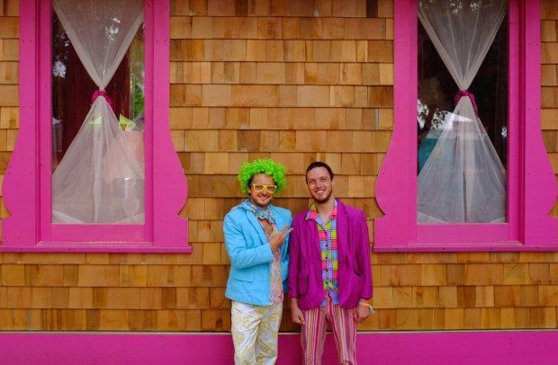 Ross (left) and his brother Grant Heidenreich (right), 24 and 25, pose outside of Vertex's Tickle Parlor.