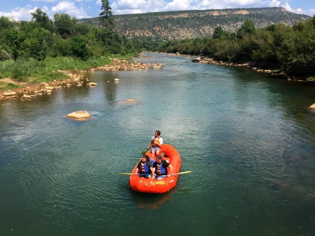Rafters and kayakers float on the Animas River through Durango, Colorado inlate August 2015