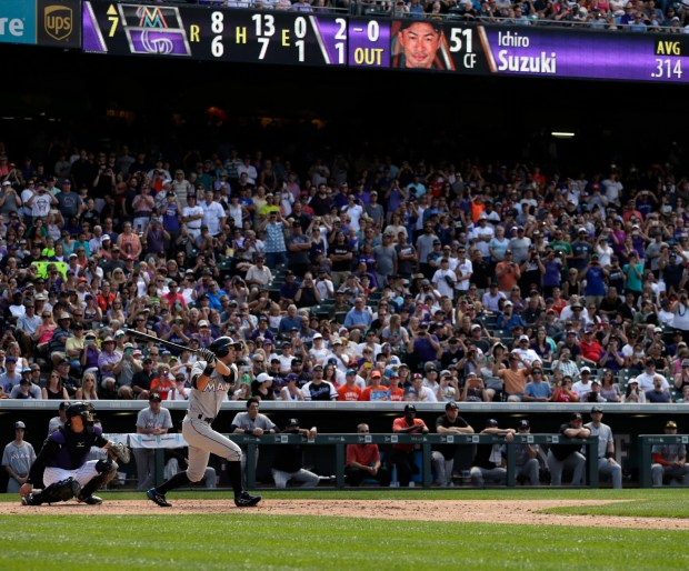 Miami Marlins' Ichiro Suzuki hits a triple for the 3,000th hit of his Major League Career during a baseball game against the Colorado Rockies in Denver, Sunday, Aug. 7, 2016.(AP Photo/Joe Mahoney)
