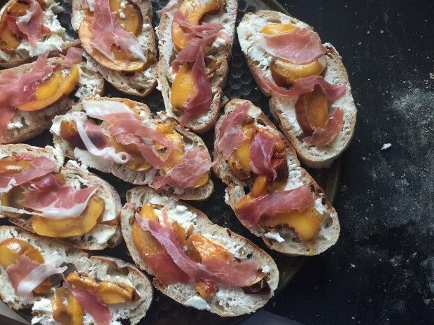 Sliced, grilled Palisade peaches on ciabatta bread with quark cheese and prosciutto