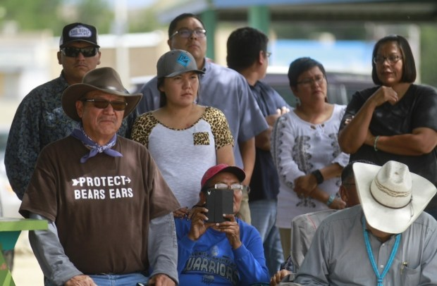 Shiprock community members listen as Navajo Nation officials announce a lawsuit against the EPA.