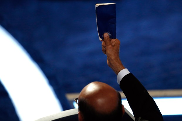 Khizr Khan holds up a copy of the U.S. Constitution during his July 28 speech at the Democratic National Convention in Philadelphia.